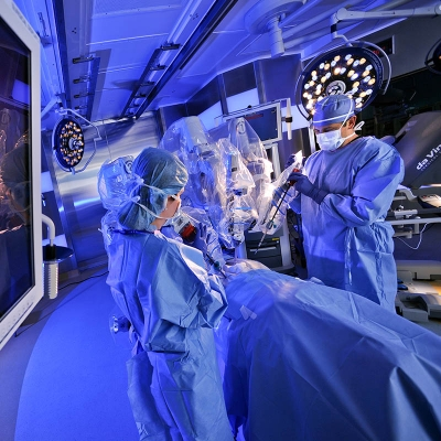 Neurologist performing a robotic assisted surgery