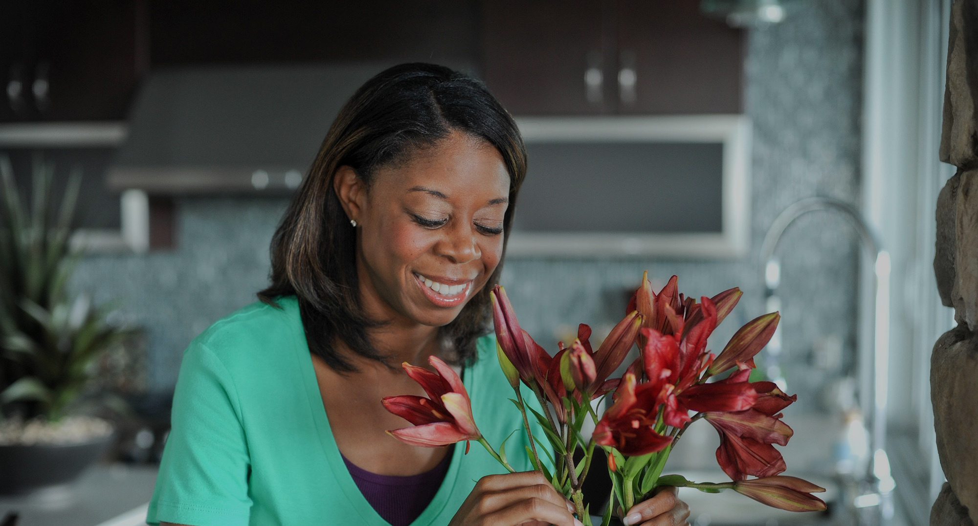 Woman arranging flowers at home.